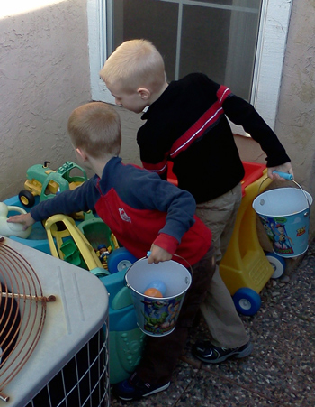 Brothers looking for Easter eggs together