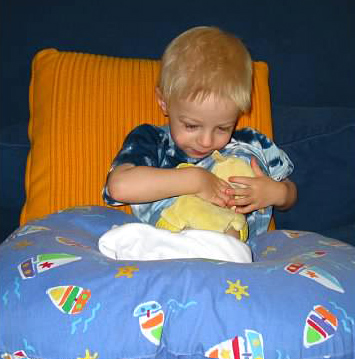 My son breastfeeding his lovey with the Boppy pillow