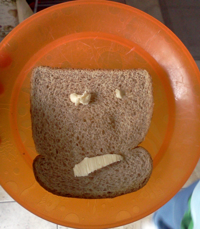 The not so happy face on toast