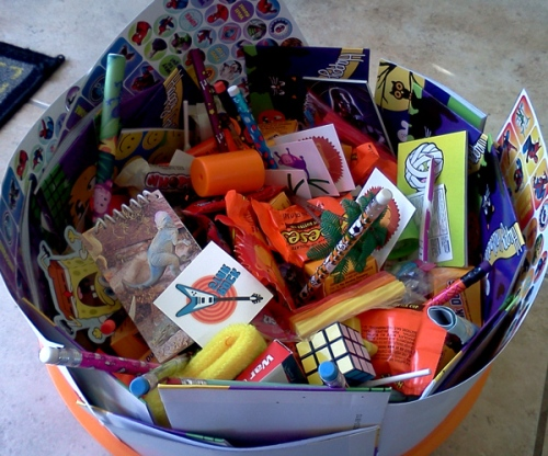 Halloween bowl with candy and toys
