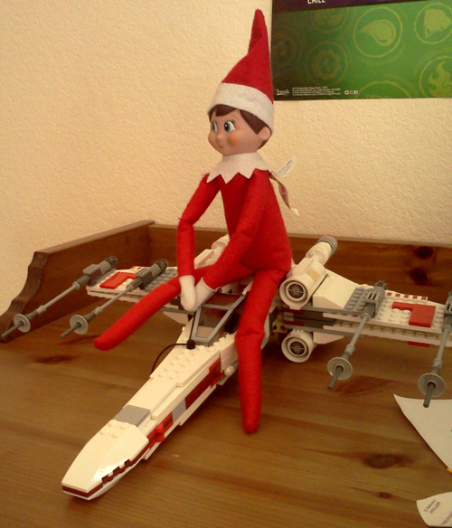 Wink rides a Lego Star Wars X-wing fighter